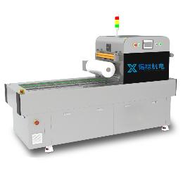 XL-JXT600连续式真空贴体包装机